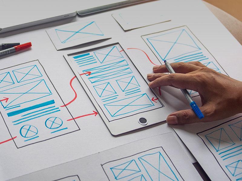esquisse de wireframe pour expliquer la navigation d'un site internet sur mobile
